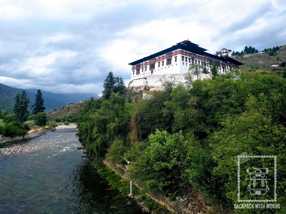 Calm river flowing with the paro dzong in the backdrop.