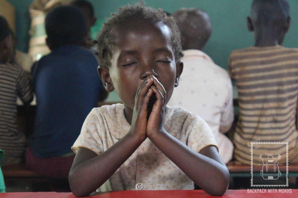 child praying before meal